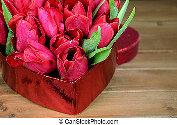 red tulips in heart box