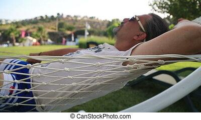Closeup Of Relaxing Man In Hammock