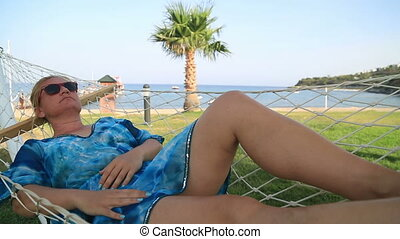 Closeup Of Relaxing Woman In Hammock