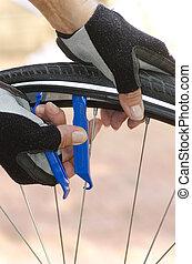 Closeup of repairing bicycle tyre
