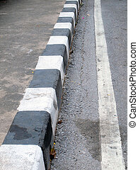closeup of road with brown and white line