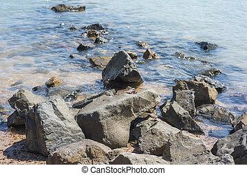 Closeup of rocks on a beach shore