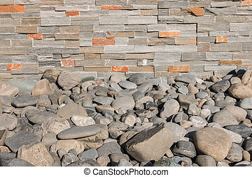 rocks with stone veneer wall