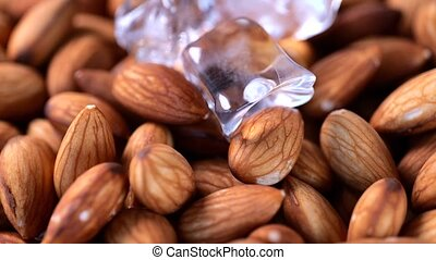 Closeup of rotating soaked overnight almond nuts with ice. Healthy food concept