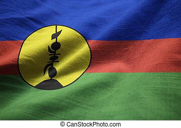 Closeup of Ruffled New Caledonia Flag, New Caledonia Flag Blowing in Wind