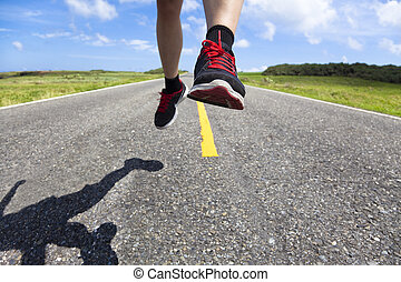 closeup of running legs on the road