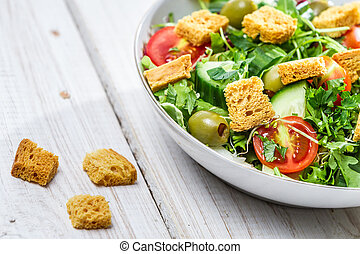 Closeup of salad with chicken and fresh vegetables
