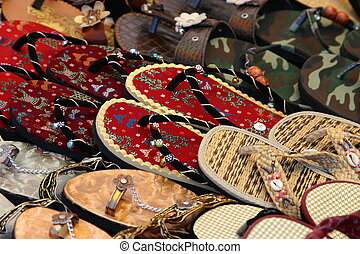 Closeup of sandals for sale in market