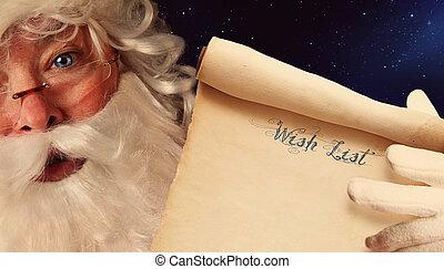 Closeup of Santa Clause holding wish list scroll