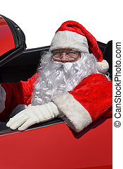 Santa sitting behind the wheel of a red sports car