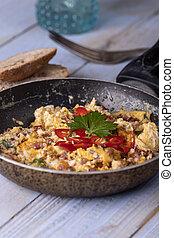 closeup of scrambled eggs in a pan