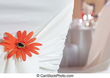 Closeup of seat back covering for a wedding - A closeup of...