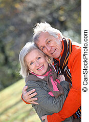 Closeup of senior couple in countryside
