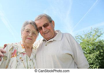 Closeup of senior couple in garden