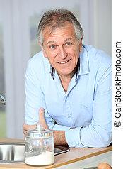 Closeup of senior man in home kitchen