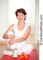 Closeup of senior woman doing stretching exercises