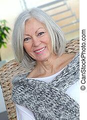 Closeup of senior woman relaxing at home