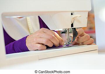 Closeup of sewing machine in use
