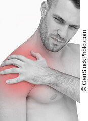 Closeup of shirtless man with shoulder pain
