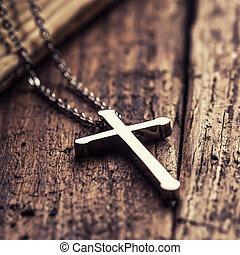 Christian cross - Closeup of silver Christian cross on bible