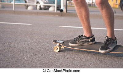 Closeup of Skateboarder Riding in Street
