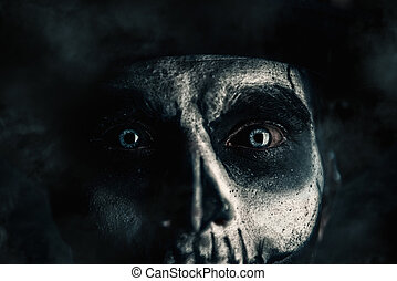 closeup of skull man - Close-up portrait of a man with a...