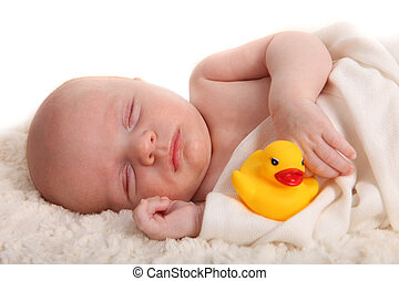 Sleeping Infant With a Rubber Duckie on White - Closeup of...