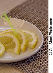 closeup of sliced lemon on a plate
