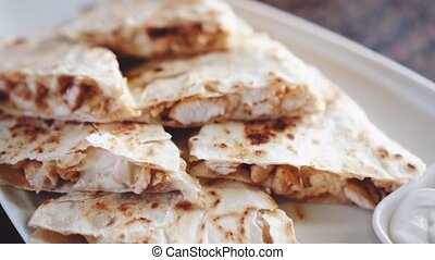 Closeup of slliced chicken quesadilla