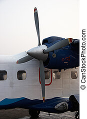 Closeup of small propeller aircraft in Kathmandu airport, Nepal
