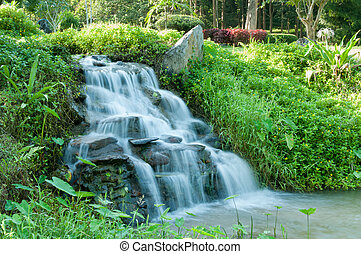 Closeup of small waterfall in the garden decorated