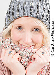 Closeup of Smiling Blonde Lady Wearing Winter Beanie and Scarf