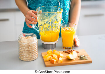 Closeup of smoothie with fresh fruits, seeds, nuts and oats