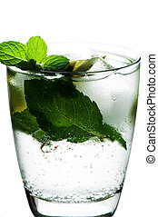 Closeup of soda water with limes and mint on White...