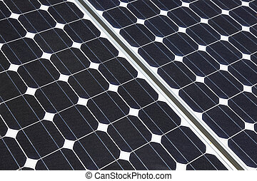 Closeup of solar panel cells mounted on roof top. Solar energy is becoming an important part of the energy mix.
