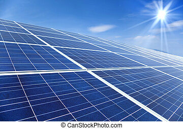 Closeup of Solar Panels with sunlight and blue sky background
