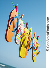 flip-flops hanging on a clothes line