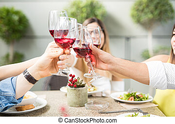 Closeup of some friends drinking wine