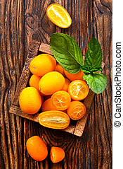 kumquat - closeup of some kumquat fruits in wooden bowl