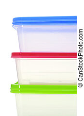 closeup of some plastic containers of different colors