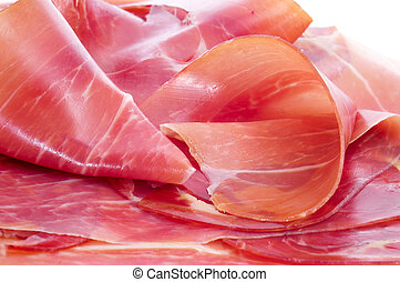 spanish serrano ham - closeup of some slices of spanish ...