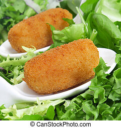 spanish croquettes - closeup of some spanish croquettes in a...