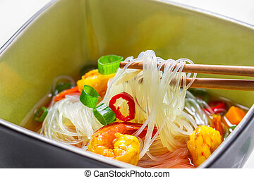 Closeup of soup with noodles and spicy shrimp