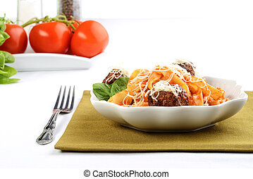 closeup of spaghetti and meatballs in a bowl