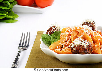 closeup of spaghetti and meatballs with cheese