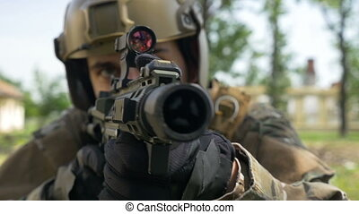 Closeup of special forces soldier watching his target...
