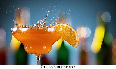 Closeup of splashing orange cocktail
