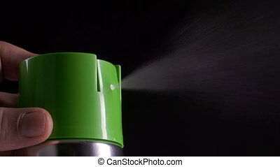 Closeup of spray can spraying aerosol insecticide or...