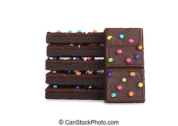 stack of chocolate fudge brownies with candy pieces on white