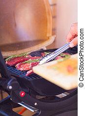 Closeup of steak fresh meat preparing on grill